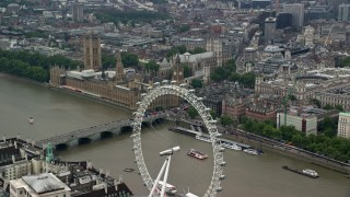 AX114_185 - 6K stock footage aerial video of approach Big Ben and Parliament from the London Eye, England