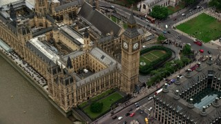 AX114_188 - 6K stock footage aerial video tilt to Big Ben and Parliament during approach from river, London, England