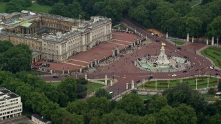 AX114_191 - 6K stock footage aerial video of flying by Buckingham Palace and Victoria Memorial, London, England