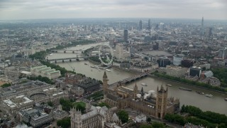 AX114_196 - 6K stock footage aerial video fly over Big Ben, Parliament and Westminster Abbey toward London Eye, England