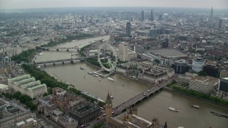 AX114_197 - 6K stock footage aerial video fly over Big Ben and Westminster Bridge toward London Eye, England