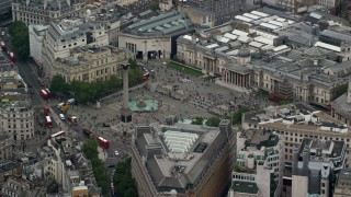 AX114_201 - 6K stock footage aerial video of an orbit of Trafalgar Square, London, England