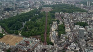 AX114_204 - 6K stock footage aerial video follow The Mall to approach Buckingham Palace, London, England