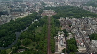 AX114_205 - 6K stock footage aerial video of flying over The Mall toward Buckingham Palace, London, England