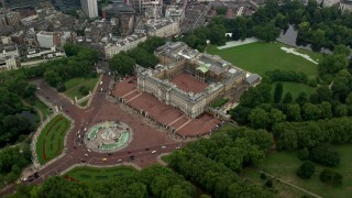 AX114_209 - 6K stock footage aerial video orbiting the Victoria Memorial monument and Buckingham Palace, London, England