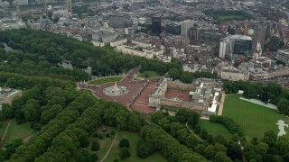 AX114_211 - 6K stock footage aerial video orbit Buckingham Palace, tilt to reveal Big Ben and Parliament, London, England