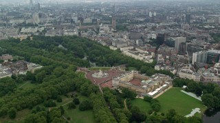 AX114_212 - 6K stock footage aerial video orbit Buckingham Palace, London Eye and Parliament in the distance, London, England