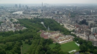 AX114_213 - 6K stock footage aerial video orbit Buckingham Palace with wide view of the city, London, England