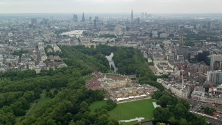 AX114_214 - 6K stock footage aerial video of Buckingham Palace and London cityscape, England