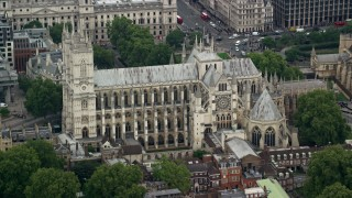 AX114_219 - 6K stock footage aerial video of orbiting Westminster Abbey, London, England