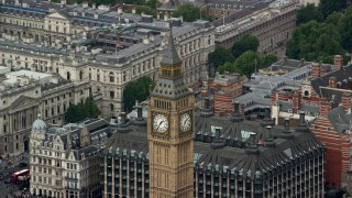 AX114_227 - 6K stock footage aerial video of orbiting Big Ben revealing HM Treasury, London, England