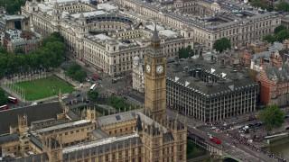 AX114_228 - 6K stock footage aerial video of orbiting Big Ben and Bridge Street, London, England