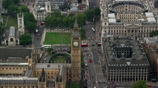 AX114_229 - 6K stock footage aerial video orbit Big Ben, Bridge Street and Portcullis House, London, England