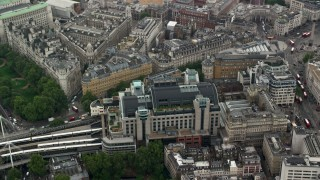 AX114_231 - 6K stock footage aerial video of Charing Cross Railway Station by River Thames, London, England