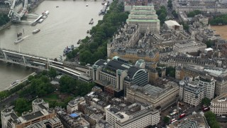 AX114_232 - 6K stock footage aerial video of Charing Cross Railway Station and Hungerford Bridge, London, England