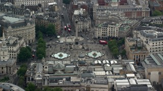 AX114_233 - 6K stock footage aerial video of Nelson's Column and fountains at Trafalgar Square, London, England