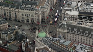 AX114_235 - 6K stock footage aerial video of orbiting Piccadilly Circus in London, England
