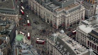 AX114_236 - 6K stock footage aerial video of orbiting Piccadilly Circus and double decker buses, London, England