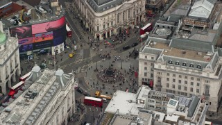 AX114_238 - 6K stock footage aerial video of orbiting double decker buses at Piccadilly Circus, London, England