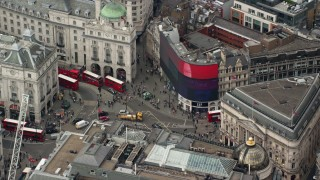 AX114_241 - 6K stock footage aerial video of an orbit around buses and traffic at Piccadilly Circus, London, England