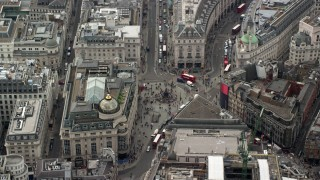 AX114_243 - 6K stock footage aerial video of Piccadilly Circus with tourists and buses, London, England