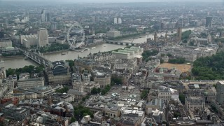 AX114_244 - 6K stock footage aerial video of London Eye and bridges spanning the River Thames, London, England