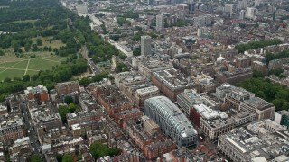 AX114_245 - 6K stock footage aerial video fly over office buildings and Park House mall near Hyde Park, London, England