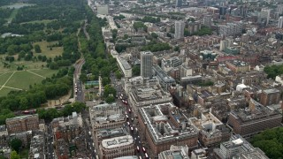 AX114_246 - 6K stock footage aerial video fly over office buildings and city streets, London, England