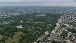 AX114_248 - 6K stock footage aerial video of Kensington Gardens and Hyde Park with trees, London, England