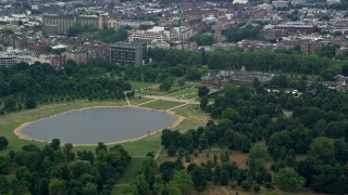 AX114_250 - 6K stock footage aerial video of a view of Kensington Palace and Round Pond, London, England