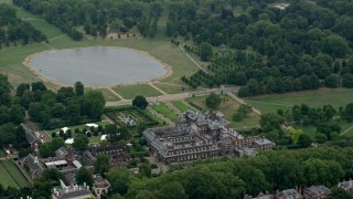 AX114_256 - 6K stock footage aerial video of orbiting Kensington Palace and Round Pond, London, England