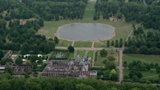 AX114_257 - 6K stock footage aerial video of circling Kensington Palace and Round Pond, London, England