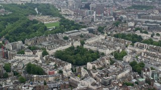 AX114_264 - 6K stock footage aerial video of orbiting Belgrave Square and embassies, London, England