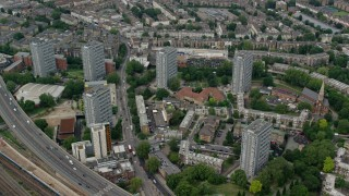 AX114_268 - 6K stock footage aerial video of orbiting apartment buildings, London, England
