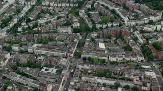 AX114_270 - 6K stock footage aerial video of an orbit of residential neighborhoods, London, England