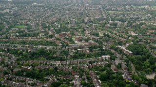 AX114_276 - 6K stock footage aerial video fly over residential neighborhoods to approach church, London, England