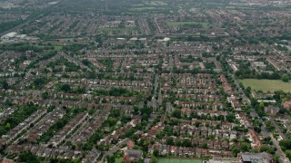 AX114_278 - 6K stock footage aerial video fly over homes in residential neighborhoods, London, England