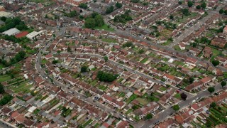 AX114_282 - 6K stock footage aerial video tilt to homes while flying over residential neighborhood in Southall, England