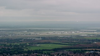 AX114_284 - 6K stock footage aerial video of commercial jet leaving London Heathrow Airport, England
