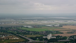 AX114_288 - 6K stock footage aerial video of approaching London Heathrow Airport, England