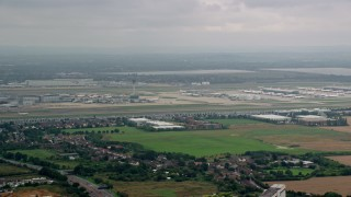 AX114_289 - 6K stock footage aerial video approach jet on the runway at London Heathrow Airport, England