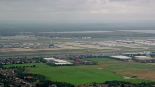AX114_290 - 6K stock footage aerial video track commercial jet taking off from London Heathrow Airport, England