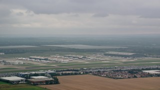AX114_291 - 6K stock footage aerial video of tracking jet ascending from London Heathrow Airport, England