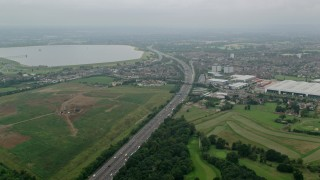 AX114_295 - 6K stock footage aerial video of M4 Freeway and warehouses, Slough, England