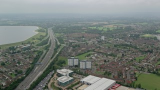 AX114_297 - 6K stock footage aerial video fly over residential neighborhoods by M4 Freeway, Slough, England