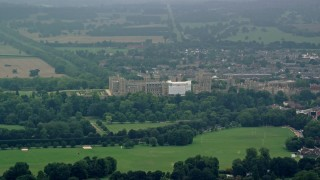AX114_303 - 6K stock footage aerial video of a view of Windsor Castle and green trees, England