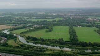 AX114_304 - 6K stock footage aerial video of flying over the Thames toward Windsor Castle, England