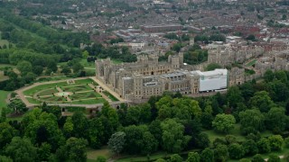 AX114_307 - 6K stock footage aerial video of flying by historic Windsor Castle and East Terrace Lawn, England
