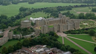 AX114_312 - 6K stock footage aerial video flyby Windsor Castle, England