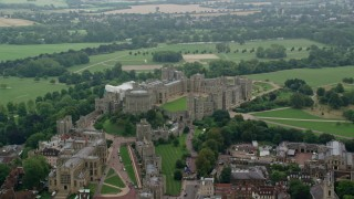 AX114_314 - 6K stock footage aerial video of passing by Windsor Castle and St George's Chapel, England